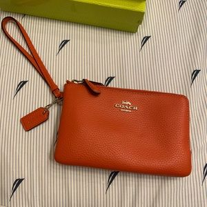 Coach wristlet orange like new